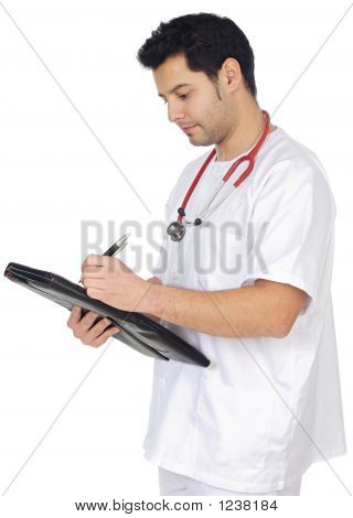 Young Doctor Taking Notes In A Notebook