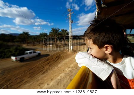 boy in truck to watch on the road 8-9, adventure