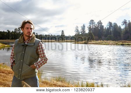 Man standing by lake, Bluff Lake, Big Bear, California, USA