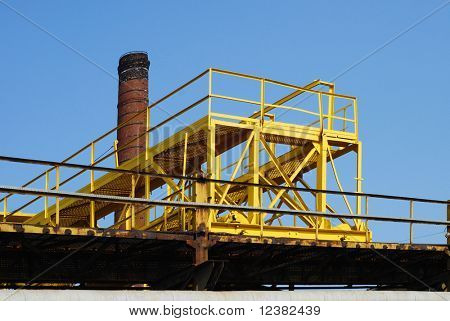 Gantry crane against blue sky background