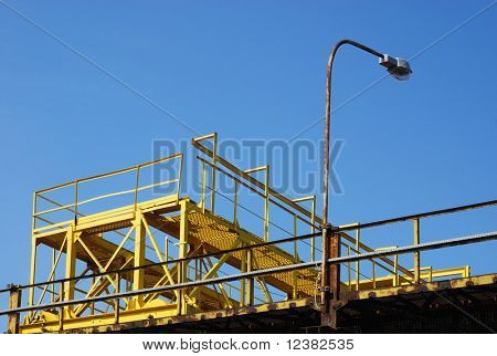 Gantry crane against blue sky background