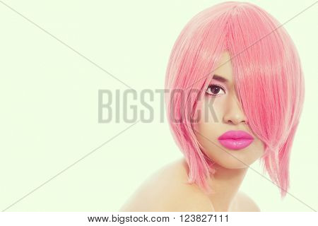 Vintage style portrait of young beautiful asian girl with pink choppy bob haircut