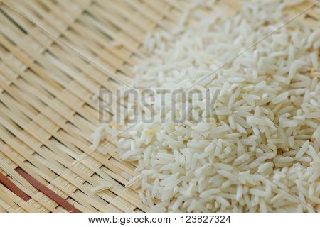 Raw rice on beautifully crafted rattan tray