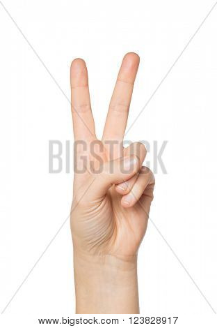 gesture and body parts concept - close up of woman hand showing peace or victory sign
