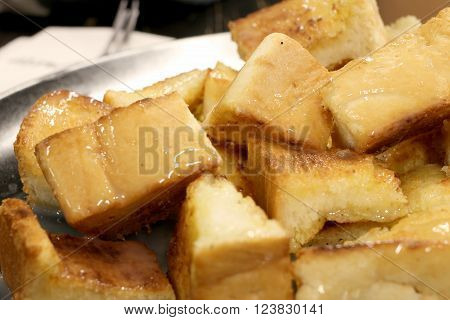 Bread Toast With Butter And Condensed Milk In A Plate, Select Focus