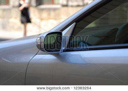Car standing on the street. Rear view sie mirror