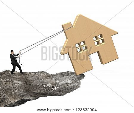Man pulling rope to move wooden house on cliff edge isolated on white.