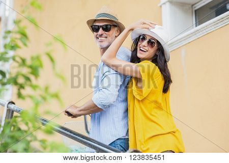 Portrait of stylish couple strolling outdoors