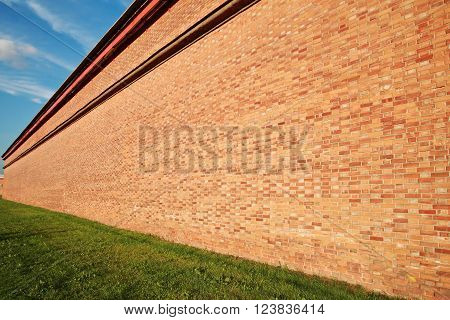 Brick wall in perspective receding into the distance