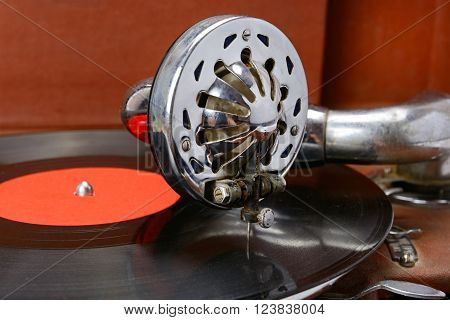A old gramophone and a vinyl record