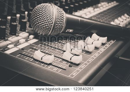 the microphone on sound mixer music background. ** Note: Soft Focus at 100%, best at smaller sizes