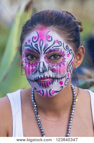 OAXACA MEXICO - NOV 02 : Unknown participant on a carnival of the Day of the Dead in Oaxaca Mexico on November 02 2015. The Day of the Dead is one of the most popular holidays in Mexico