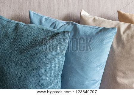 Four cushions stack on couch (close up)