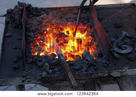 Here it is represented forge brazier with hot coals