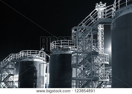 icy covered oil storage tanks in the North