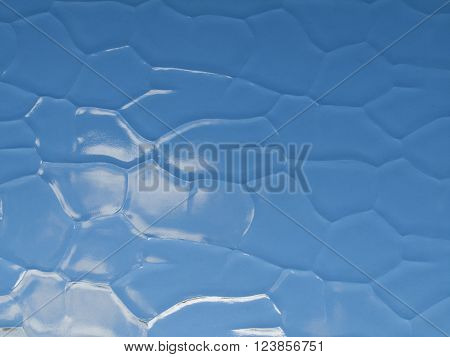 Abstract sky background shot through dappled glass window
