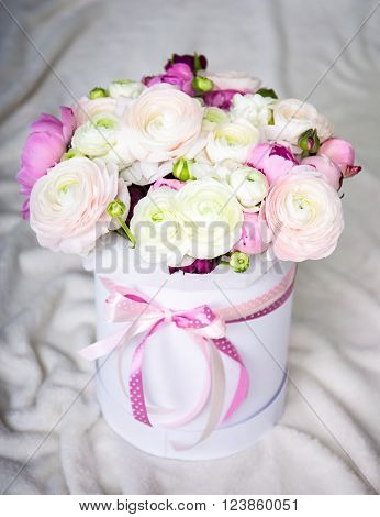big bouquet of summer flowers in round box over white