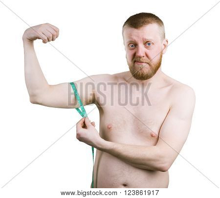Bearded young man measures the size of your biceps