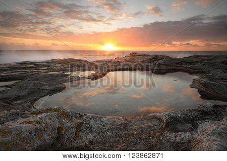 Yena Bay rockshelf sunrise reflections in one of the rockpools