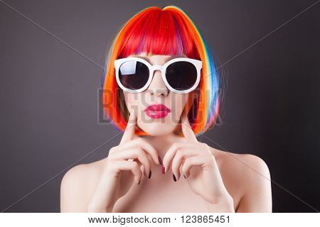 Beautiful Woman Wearing Colorful Wig And White Sunglasses