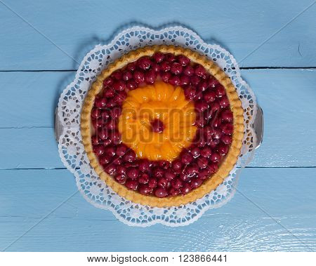 Fruitcake With Cherries And Tangerines On Blue Wood