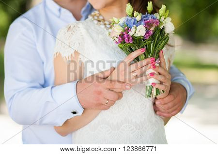 Wedding Bouquet Of Flowers In Hands Of Beautiful Anonymous Young Bride And Groom