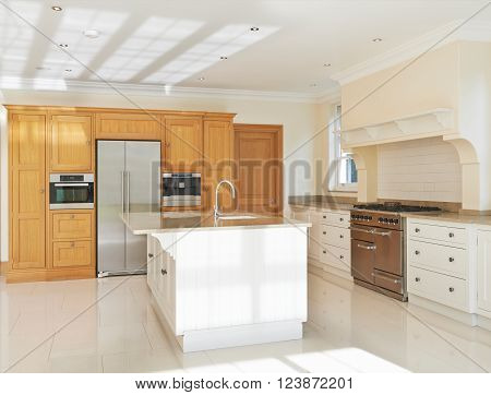 Empty Luxury Fitted Kitchen In Modern House