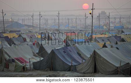 ALLAHABAD, INDIA - FEBRUARY 10, 2013: Maha Kumbh Mela festival pilgrim camp, the world's largest religious gathering.
