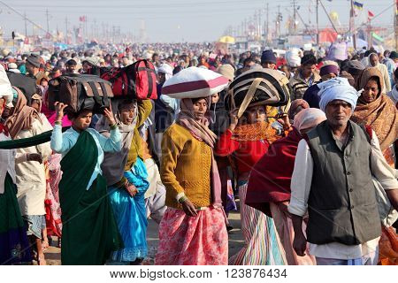 ALLAHABAD, INDIA - FEBRUARY 9, 2013: Hindu devotees come to confluence of the Ganges and Yamuna River for ritual holy bathing during the festival Kumbh Mela. The world's largest religious gathering