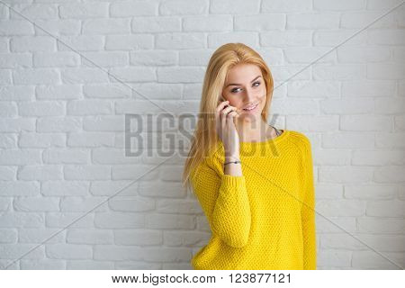 Pretty Blonde Talking On The Mobile Phone