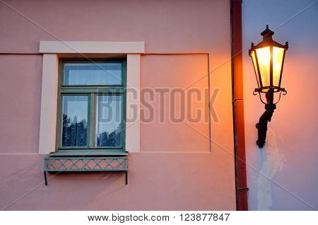 Glory lamp and the window in old city