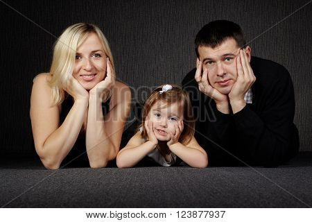 photo of happy family on dark background