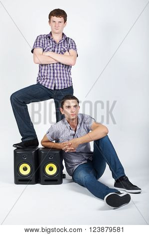 photo of two funny boys with speakers