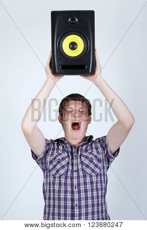 photo of man with speaker loud shouting