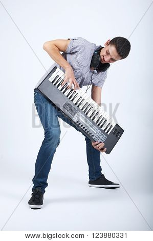 photo of boy with piano on bright background