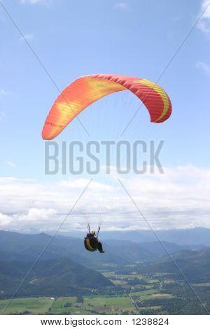 Photograph Of A Paraglider Pilot Soaring