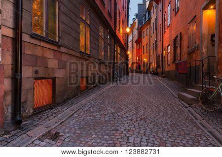 Gamla Stan street illuminated at night, Stockholm, Sweden