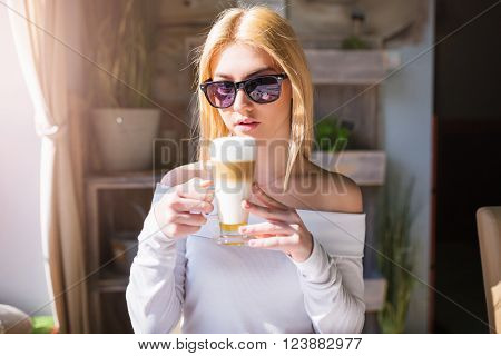 Girl Savouring Delicious Coffee