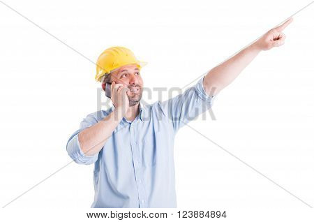Confident and visionary engineer or architect talking on the phone and pointing finger up