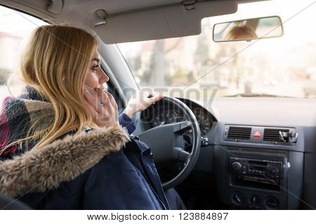 Girl Driving And Talking On The Mobile