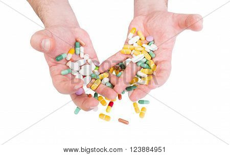 Pills abuse or painkillers concept with dramatic tense or strained hands holding pills