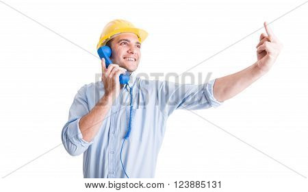 Engineer Showing Middle Finger While Talking On The Phone