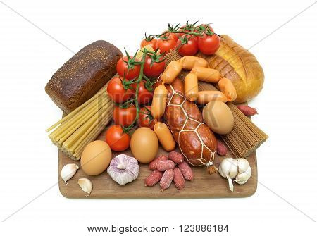 different foods on a cutting board on a white background. horizontal photo.