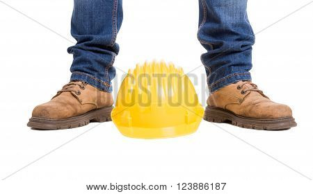 Construction worker feet and yellow helmet. Wide picture isolated on white background