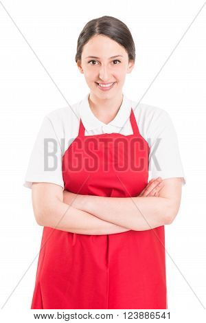 Confident and young female supermarket employee with arms crossed