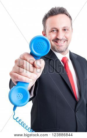 Sales Man Showing Telephone To The Camera