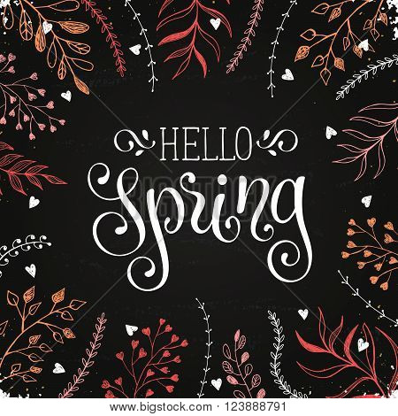 Hello spring lettering with doodle branches on chalkboard. Spring time wording. Modern calligraphy for greeting card design.