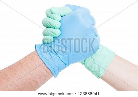 Competitive doctors arms wrestling on white background