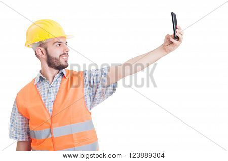 Builder taking a selfie suing smartphone isolated on white background