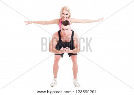 Fitness Couple Of Trainers Having Ful With Piggyback